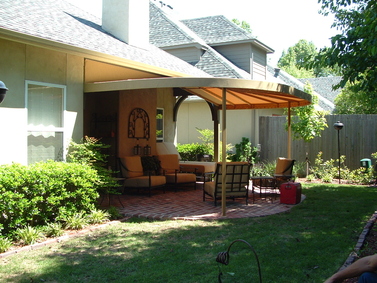 Curved front gabled patio awning.